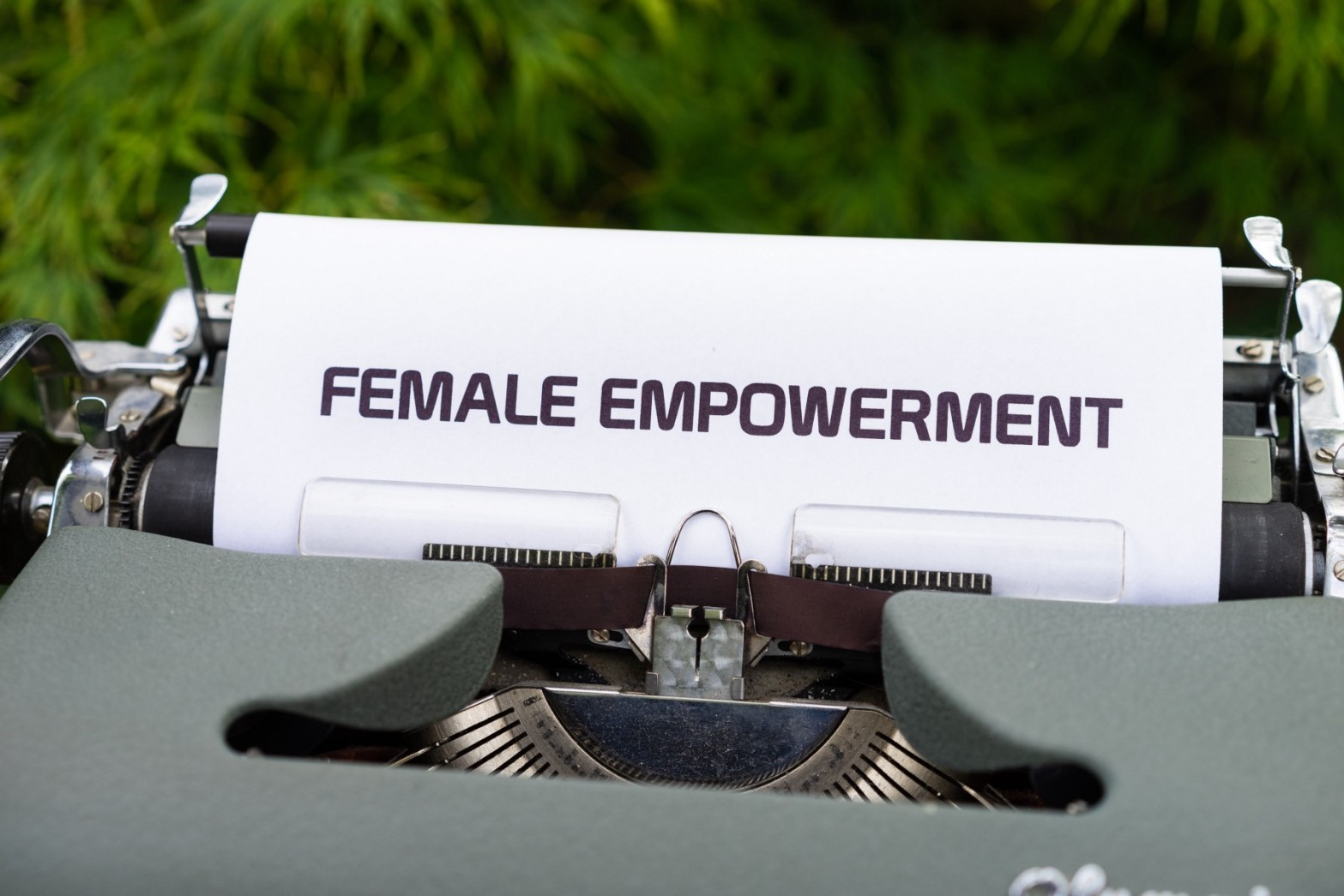 """Typewriter with paper sticking out reading """"female empowerment"""" in capital letters"""