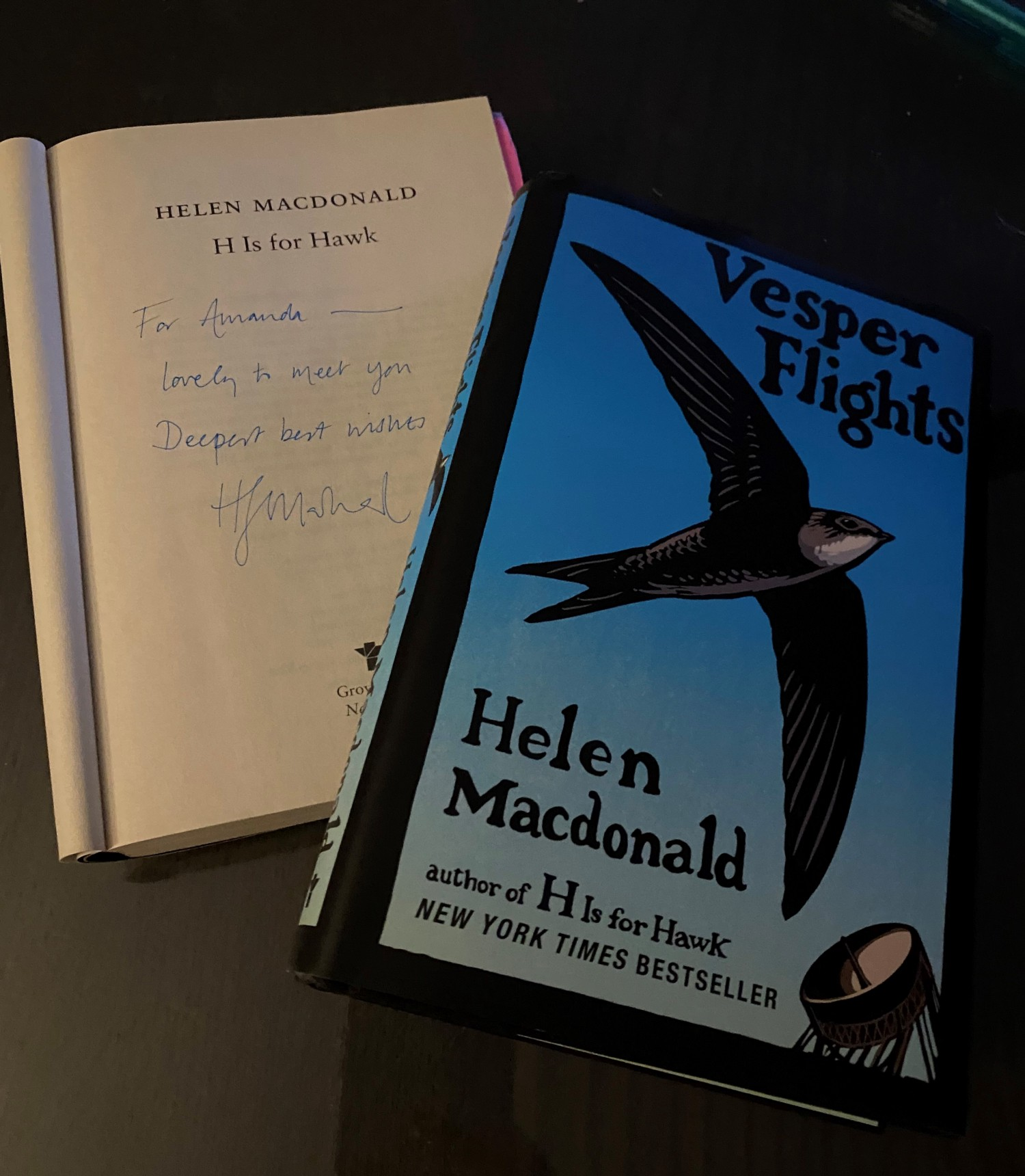 Vesper Flights by Helen Macdonald and an open H is for Hawk and signed by the author