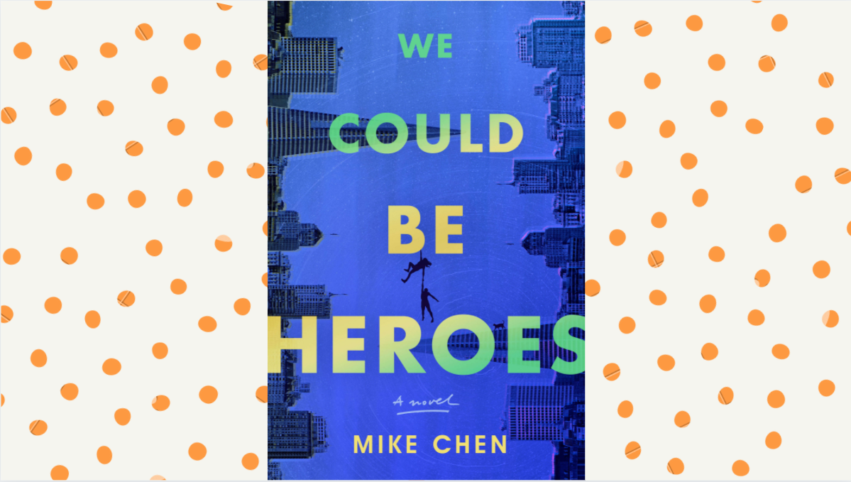 We could be heroes cover on a cream background with orange polka dots. Cover is dark blue with a city scape outline on moth edges.